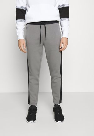 SOLID MIX BACK LOGO PANTS - Tracksuit bottoms - grey