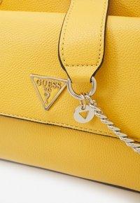 Guess - SANDRINE CONVERTIBLE CROSSBODY - Across body bag - yellow - 5
