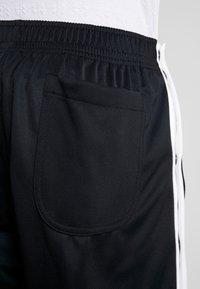 Nike Sportswear - TEARAWAY  - Tracksuit bottoms - black/white - 5