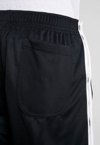 Nike Sportswear - TEARAWAY  - Træningsbukser - black/white - 5