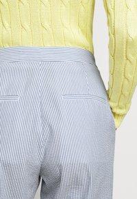 Polo Ralph Lauren - SEERSUCKER - Trousers - blue/white - 4
