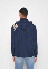 EA7 Emporio Armani - Summer jacket - dark blue/orange - 2