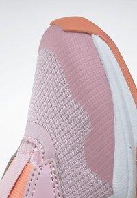 Reebok - REEBOK XT SPRINTER SLIP-ON SHOES - Stabilty running shoes - pink - 10