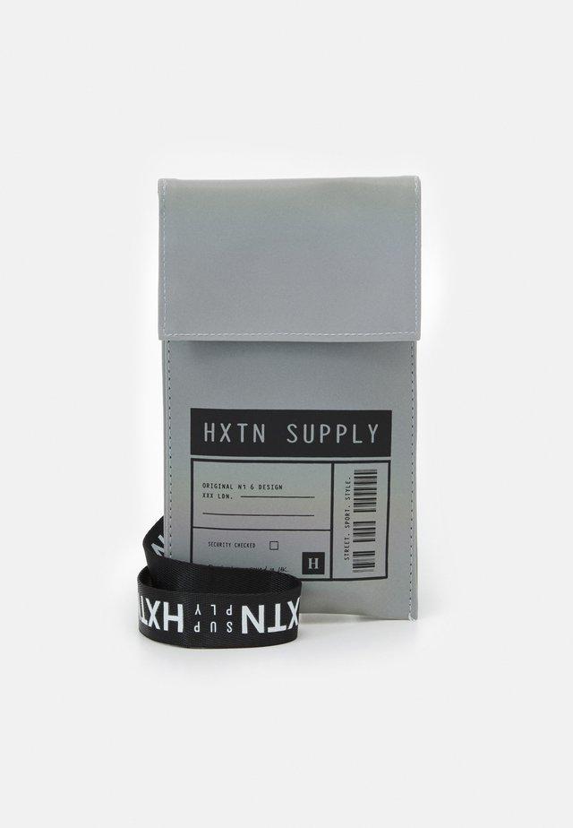 SHOULDER POUCH UNISEX - Across body bag - grey