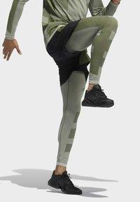 adidas Performance - STUDIO TECH SHORTS - Sports shorts - green - 4