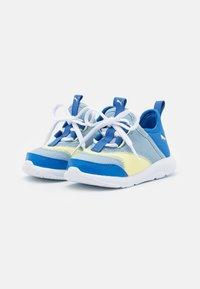 Puma - FUN RACER SLIP ON ELEVATE UNISEX - Neutral running shoes - blue fog/yellow pear - 1