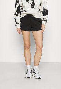 Calvin Klein Jeans - LOGO TRIM - Tracksuit bottoms - black - 0