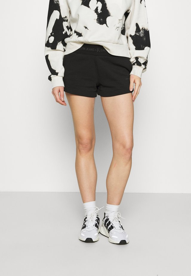 LOGO TRIM - Teplákové kalhoty - black