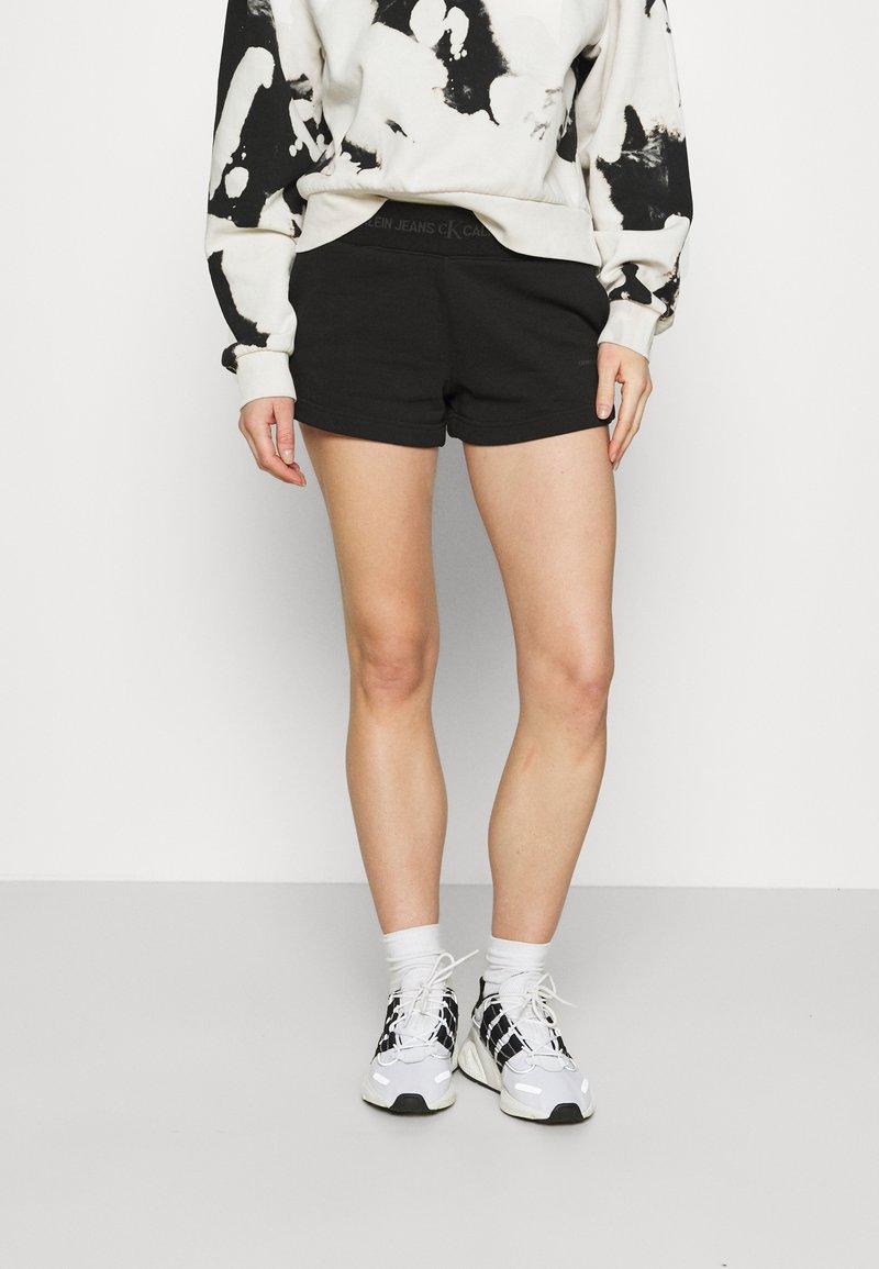 Calvin Klein Jeans - LOGO TRIM - Tracksuit bottoms - black