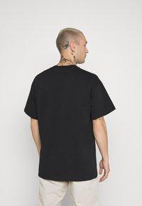 Nike Sportswear - TEE REISSUE COURT LOGO - Print T-shirt - black - 2
