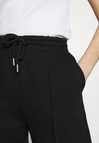 Gina Tricot - BONNIE - Teplákové kalhoty - black - 5
