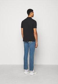 MOSCHINO - UPPER BODY GARMENT - Polo shirt -  black - 2