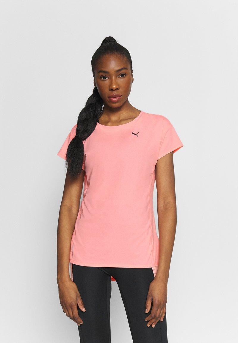 Puma - TRAIN FAVORITE TEE - Camiseta básica - elektro peach