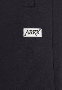 ARKK Copenhagen - BOX LOGO PANTS - Tracksuit bottoms - black - 4