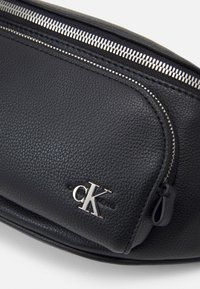 Calvin Klein Jeans - WAISTBAG FRONT POCKET UNISEX - Bum bag - black - 3