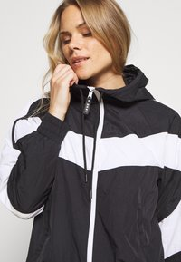 DKNY - COLORBLOCKED TRACK JACKET - Training jacket - black - 5