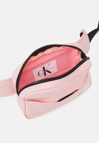 Calvin Klein Jeans - MONOGRAM BADGE WAISTBAG UNISEX - Bum bag - sand rose - 2