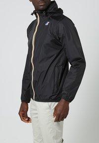 K-Way - LE VRAI CLAUDE UNISEX - Waterproof jacket - black - 2