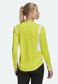 adidas Performance - OWN THE RUN 3-STRIPES RUNNING LONG-SLEEVE TOP - Long sleeved top - yellow - 1