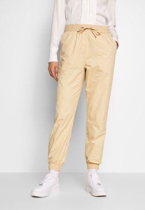 PAM TROUSERS - Trousers - beige