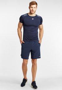 Skins - Sports shorts - navy blue - 1