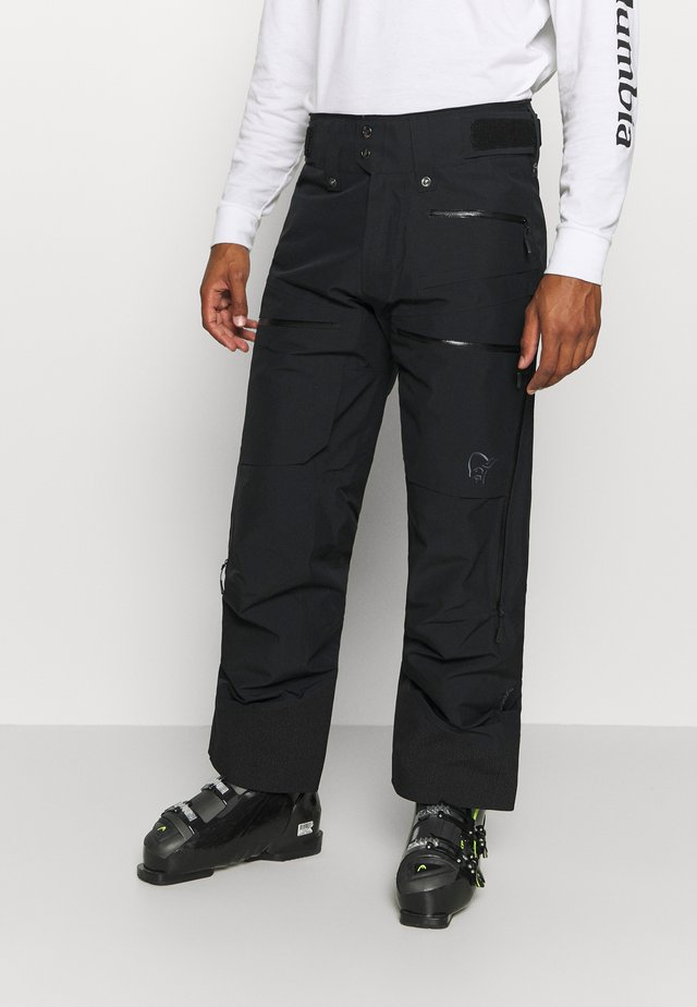 LOFOTEN - Snow pants - black