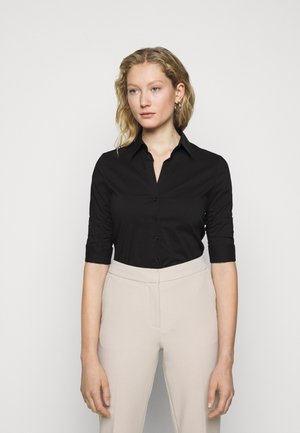 THE ESSENTIAL BLOUSE - Button-down blouse - black
