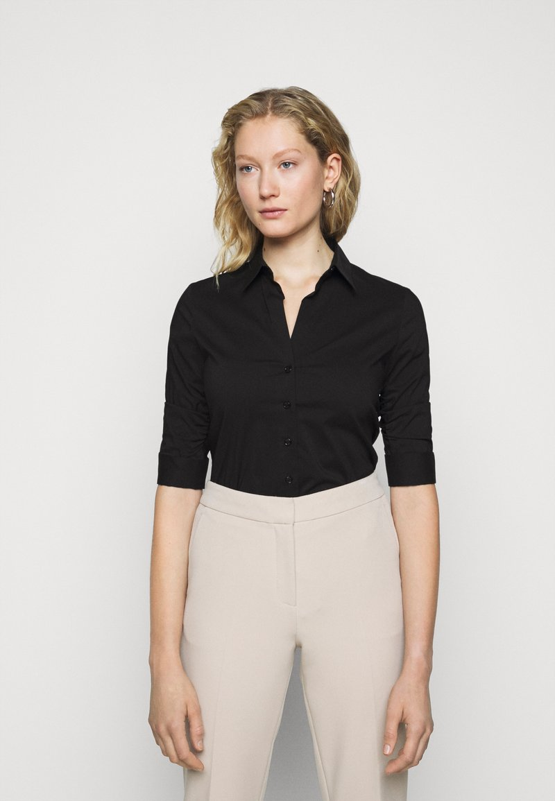 Steffen Schraut - THE ESSENTIAL BLOUSE - Button-down blouse - black