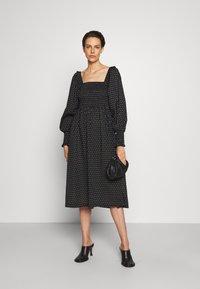 Bruuns Bazaar - ASTER SMOCK DRESS - Vestito estivo - black - 1