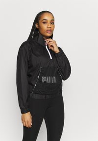 Puma - TRAIN LOGO QUARTER  - Training jacket - puma black - 0