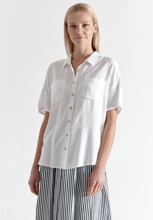 RETIKIA - Button-down blouse - white