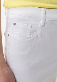 BRAX - STYLE CAROLA - Straight leg jeans - white - 3