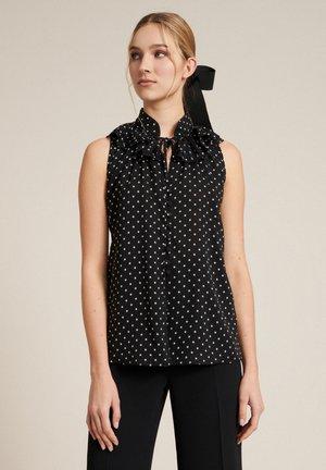 BALI - Button-down blouse - nero/pois panna