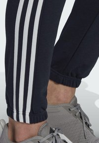 adidas Performance - ESSENTIALS FRENCH TERRY TAPERED 3-STRIPES JOGGERS - Træningsbukser - blue - 3