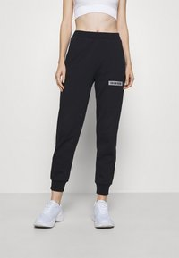 Calvin Klein Performance - PANT - Tracksuit bottoms - black - 0