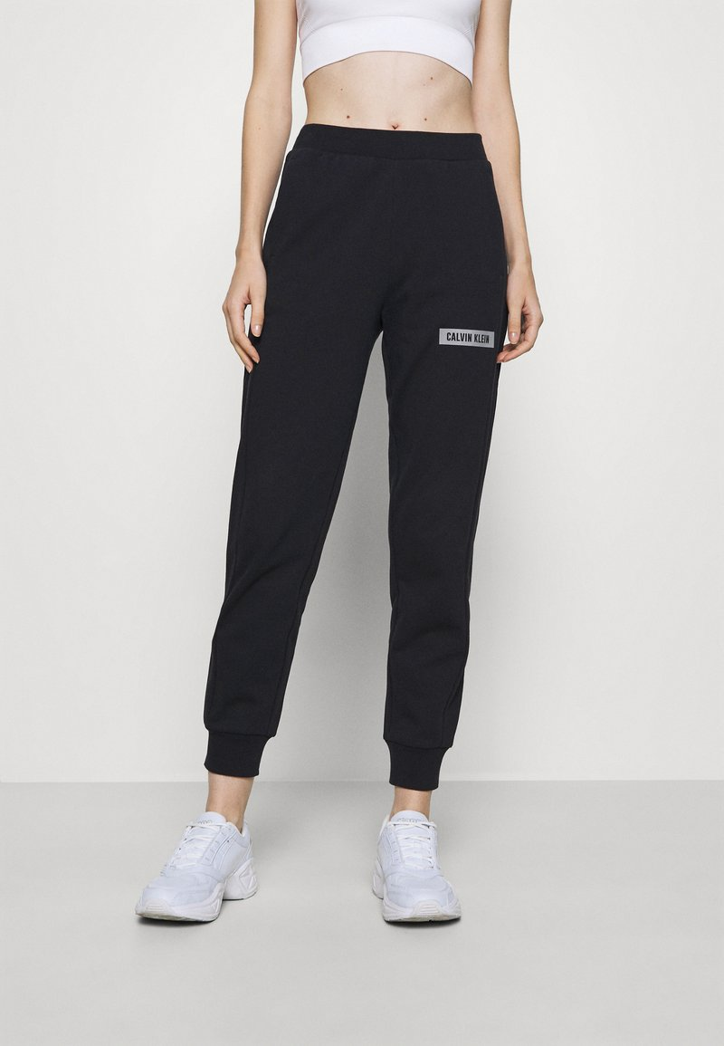 Calvin Klein Performance - PANT - Tracksuit bottoms - black