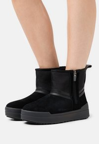 UGG - CLASSIC TECH MINI - Winter boots - black - 0