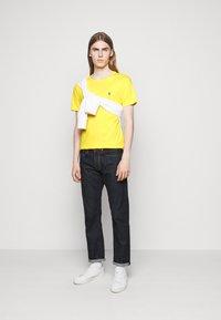 Polo Ralph Lauren - CUSTOM SLIM FIT JERSEY CREWNECK T-SHIRT - Jednoduché triko - racing yellow - 1