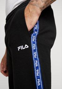 Fila - USMAN  - Tracksuit bottoms - black - 5