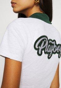 Missguided - PLAYBOY VARSITY BODYSUIT - Polo shirt - grey - 6