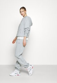 Nike Sportswear - PANT - Tracksuit bottoms - smoke grey