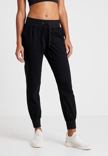 COMFORT PANTS - Pantalones deportivos - black