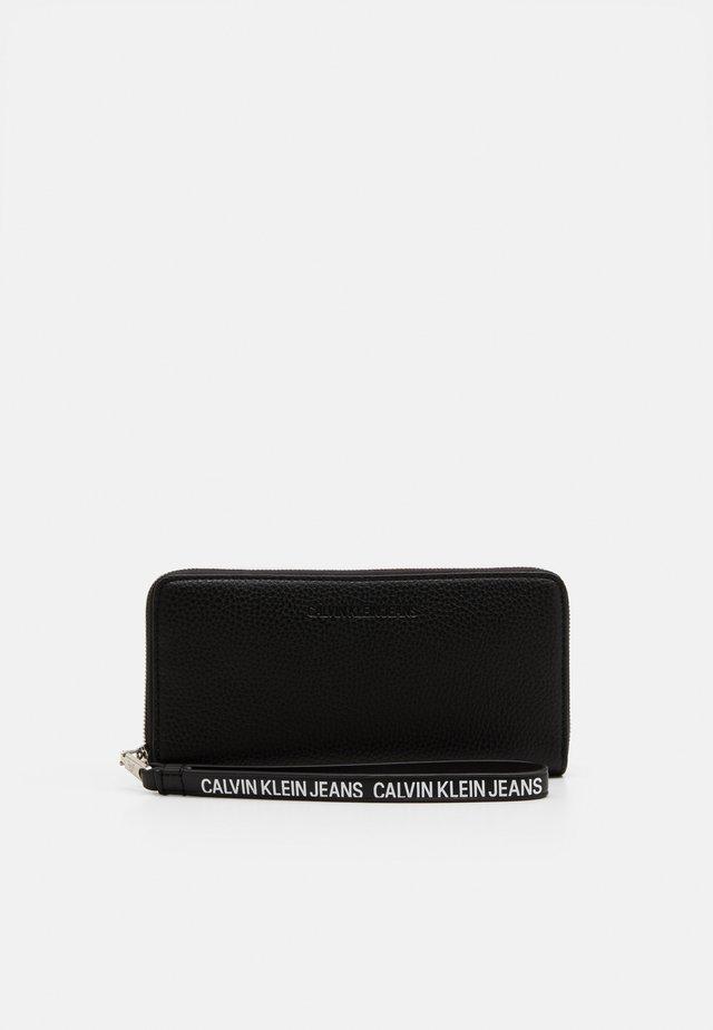 ZIP AROUND WRISTLET - Peněženka - black