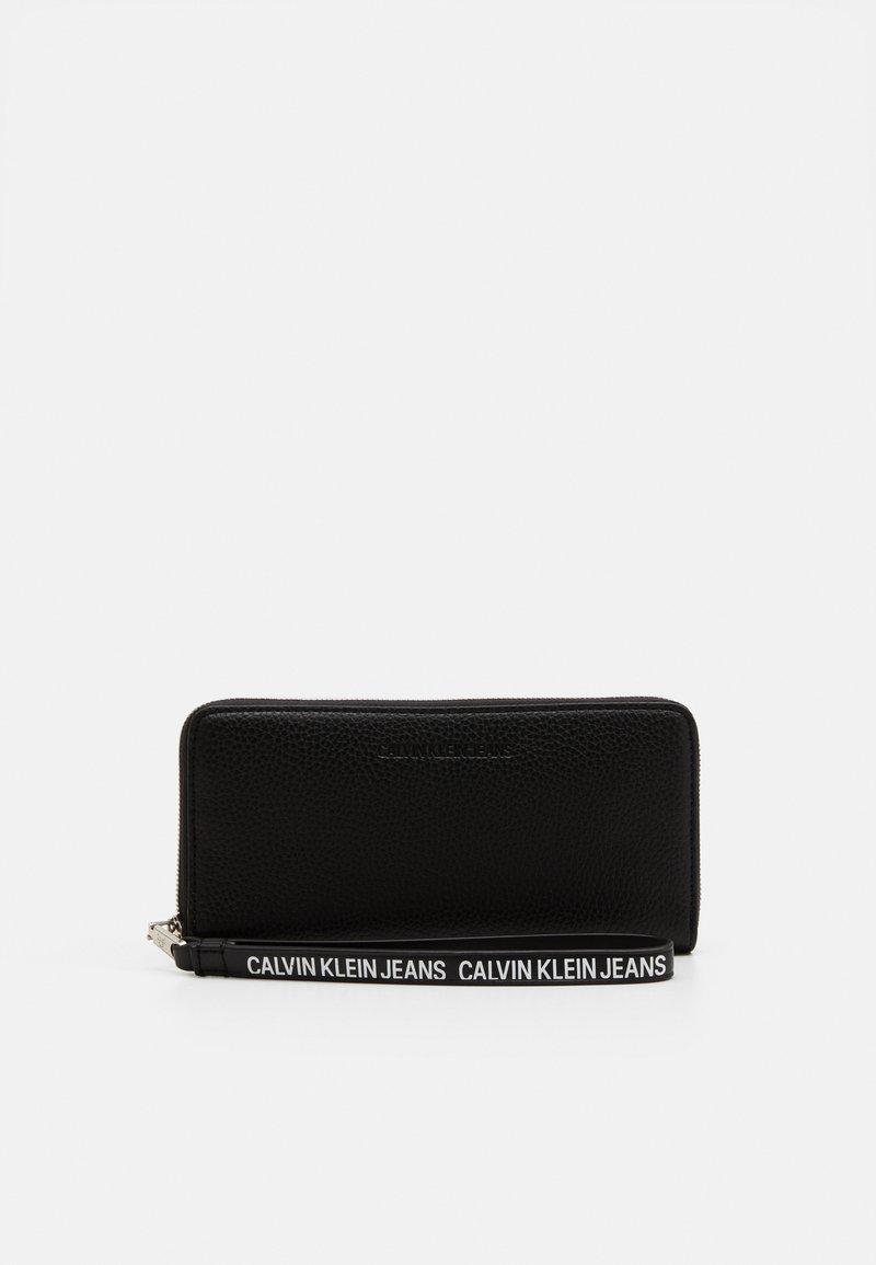 Calvin Klein Jeans - ZIP AROUND WRISTLET - Wallet - black