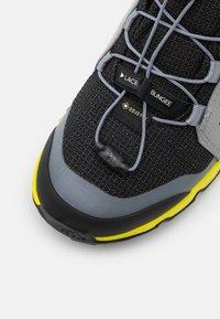 adidas Performance - TERREX MID GTX UNISEX - Hiking shoes - core black/grey three/acid yellow - 5