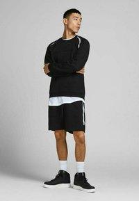 Jack & Jones - Sports shorts - black - 1