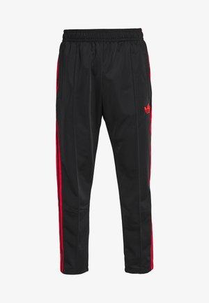 SUPERSTAR 3STRIPES TRACK PANTS - Tracksuit bottoms - black/red