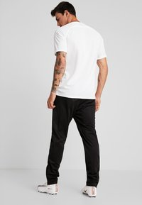 Lotto - DELTA PANT - Spodnie treningowe - all black - 2