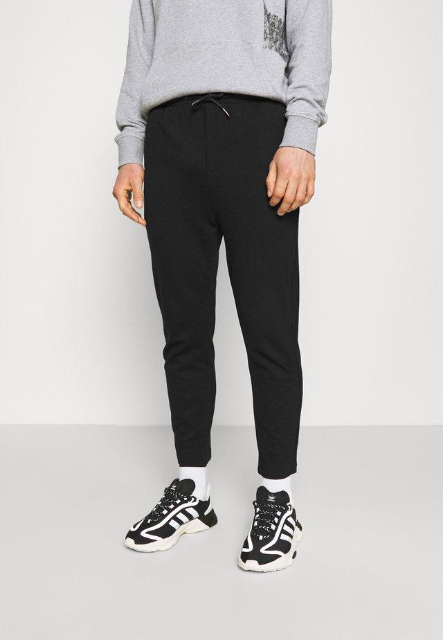 PANTS CROPPED - Pantaloni sportivi - black