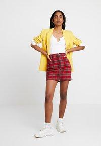 Urban Classics - LADIES SHORT CHECKER SKIRT - Mini skirt - red/black - 1